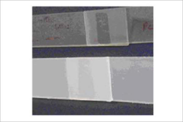Figure 1: Welded polypropylene (top sample) and polycarbonate (lower sample) lap shear samples