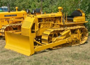 Heavy machinery such as bulldozers can have dissimilar metal plates welded on to protect against abrasion